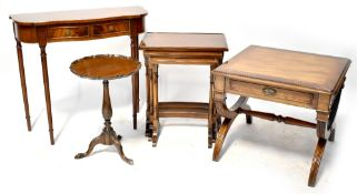 A Regency-style mahogany nest of three tables,