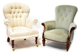 A Victorian-style button-back armchair upholstered in cream woven fabric and on turned legs with
