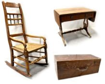 A 19th century country rocking chair, ladder back with turned decoration to outswept arms,