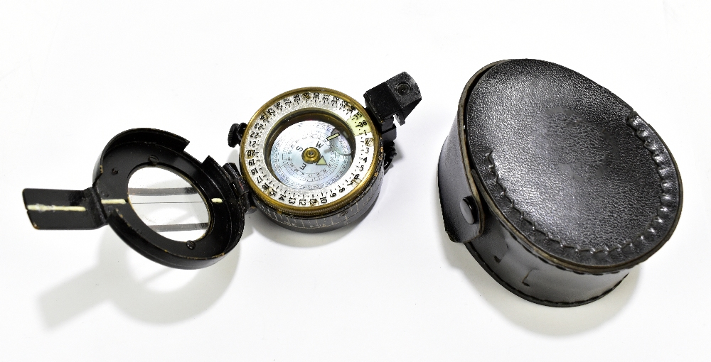 A WWII period military pocket compass inscribed 'T.G. Co Ltd, London No.833000, 1940', in associated
