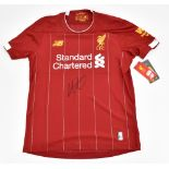 LIVERPOOL FC; a New Balance junior home shirt with Standard Chartered logo signed by Trent