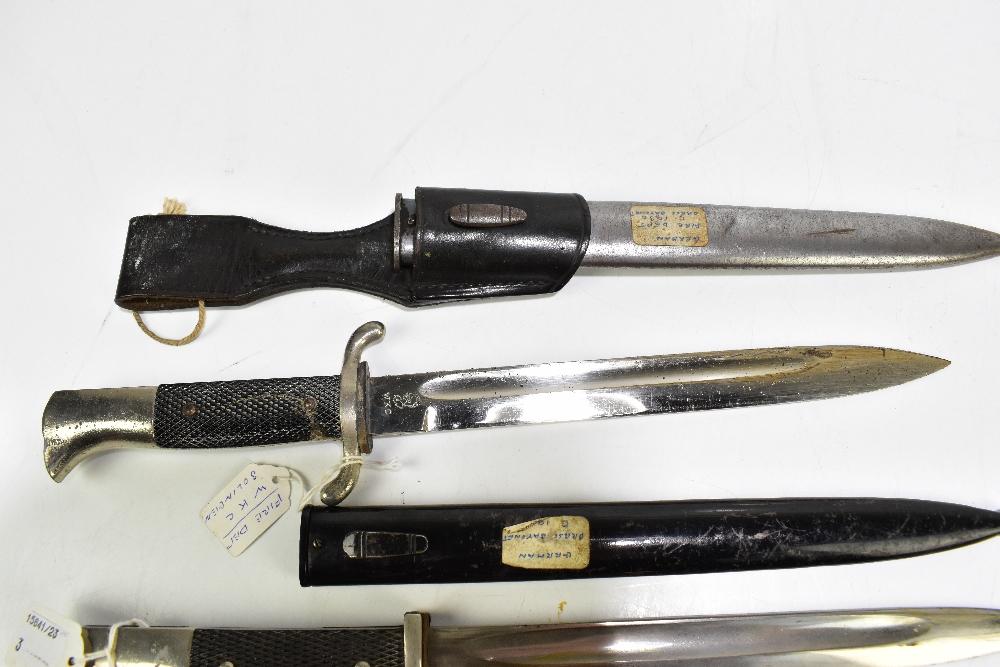 Three German bayonets comprising Alexander Coppel 1887/1930, press bayonet c1920 and c1930 Fire - Image 4 of 4