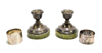PH VOGEL & CO; a pair of George VI hallmarked silver candlesticks of squat form, with a beaded