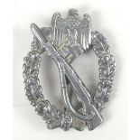 A Third Reich Infantry Assault badge, length 6cm.Additional InformationGeneral wear throughout.