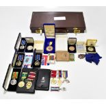 Two World War II Defence Medals, a set of miniatures, further medals to include three cased National