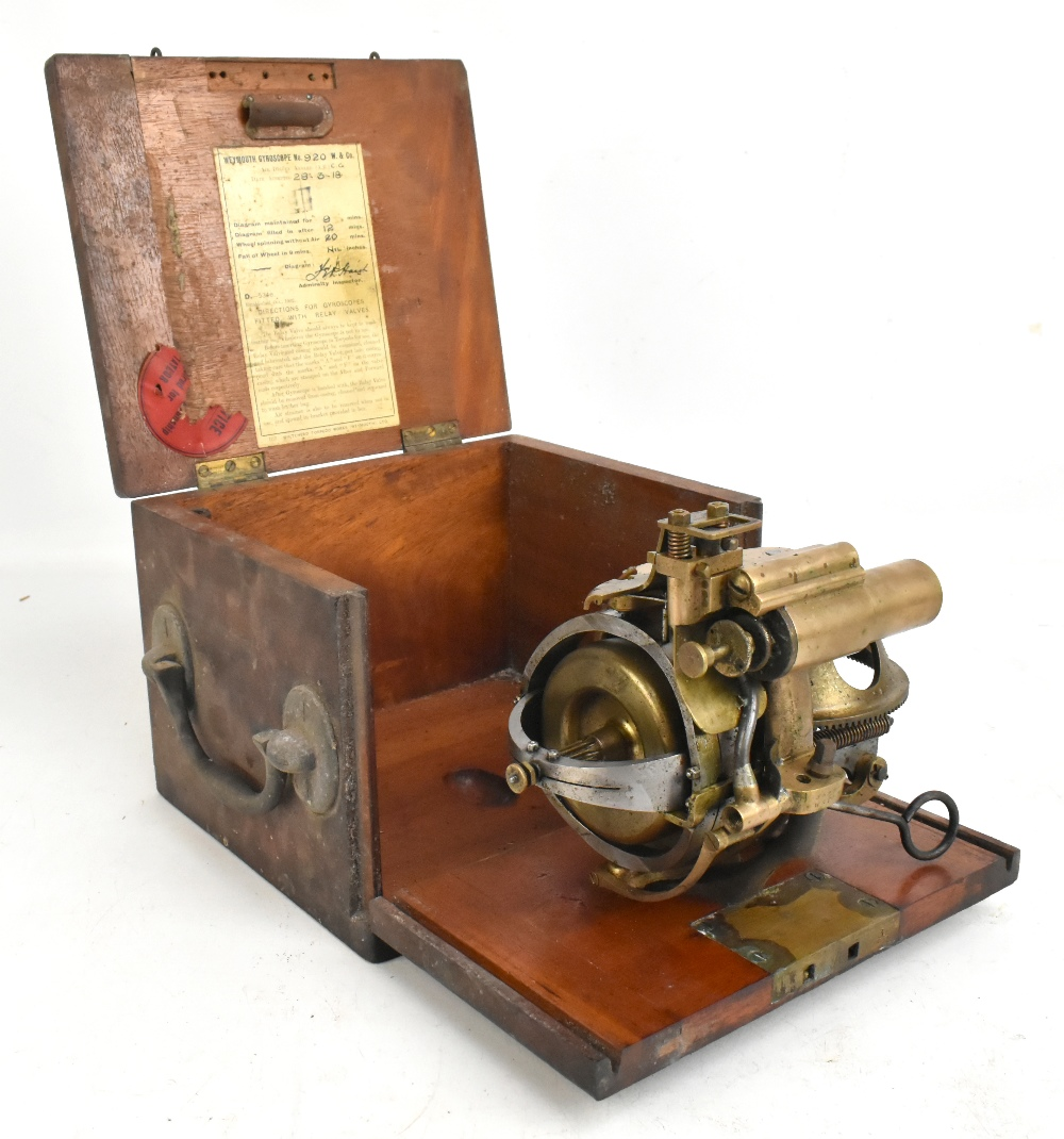 WHITEHEAD & CO; a rare torpedo steering gyroscope, fitted in mahogany case with original label to