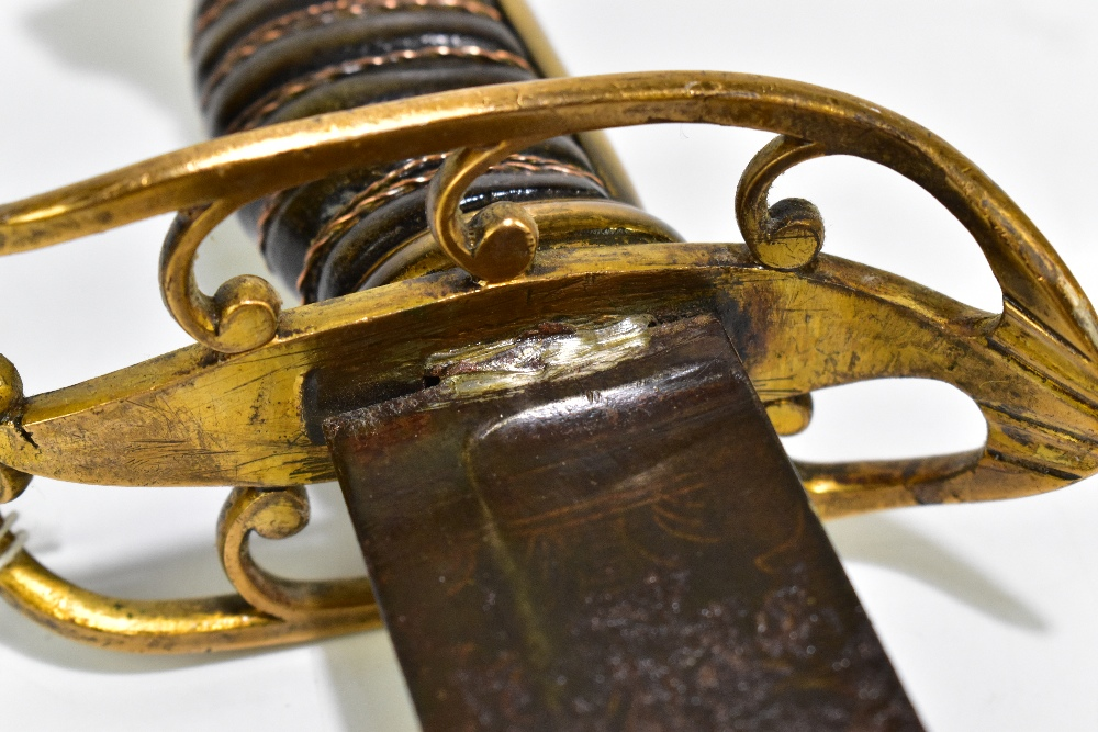 A Naval sabre/cutlass, the blade with indistinct detail, blade length 74cm, to pierced brass guard - Image 6 of 6