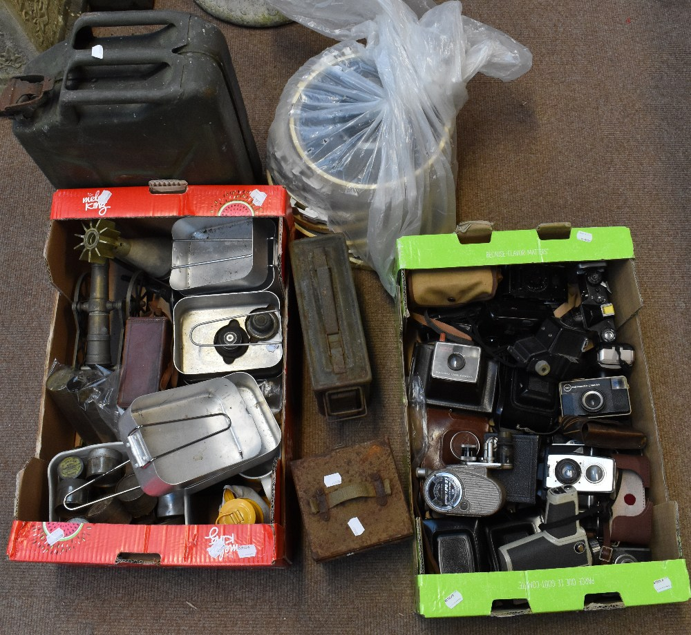 A mixed group including military issued jerry can, mixed cameras and equipment, shell casings, etc.