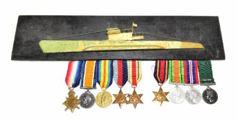 A Royal Naval Reserve World War I and World War II medal group of nine comprising War, Victory and