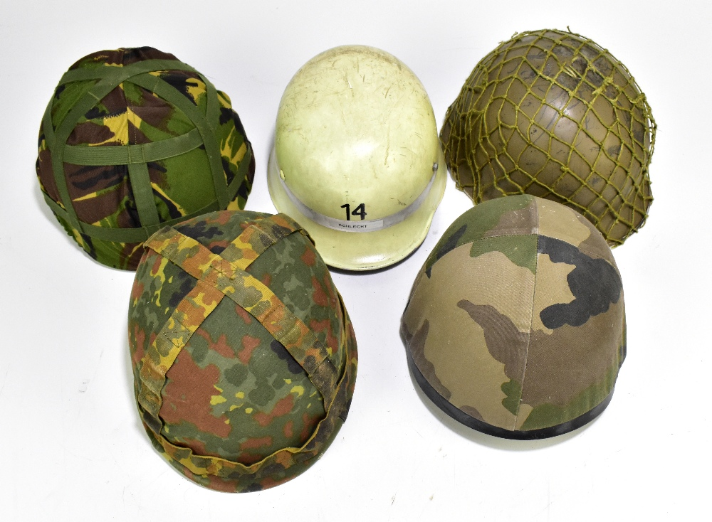 Five military and public service helmets comprising mid/late 20th century US helmet with webbing,