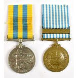 An Elizabeth II Korea and United Nations Korea Medal duo awarded to 203965 Bdr. L.S. Day.