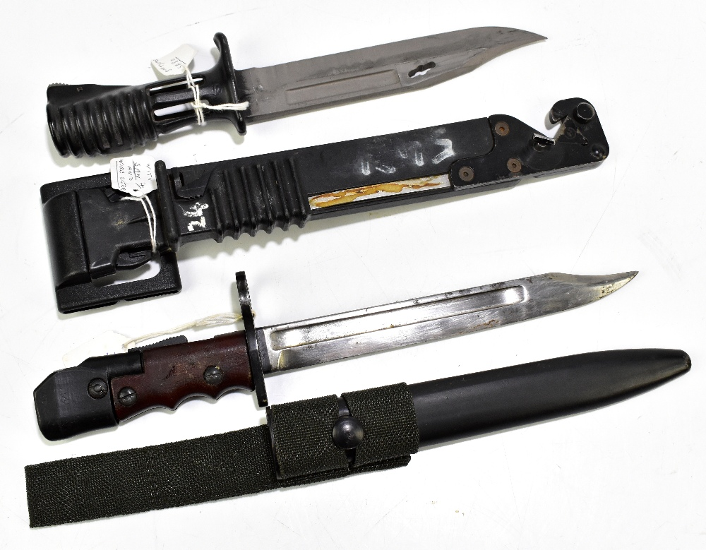 A British SA80 bayonet with saw and wire cutter and further No.7 Mk I/L bayonet, both with scabbards