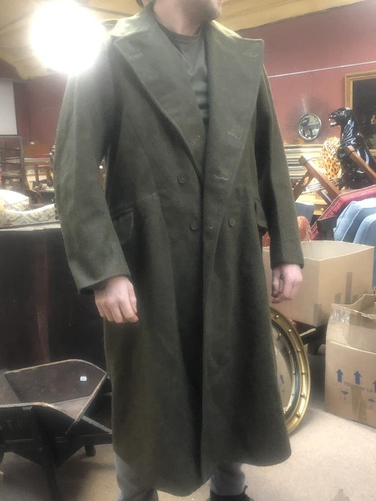 Three military greatcoats, two khaki and one navy (3). Additional InformationFraying, loose - Image 2 of 6