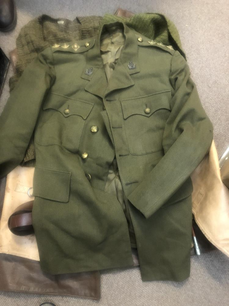 A collection of military uniform and accessories including two woolen great coats, two leather - Image 5 of 6
