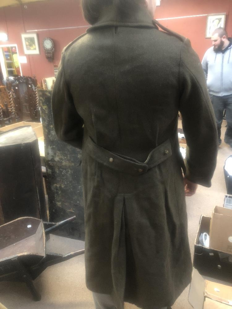 Three military greatcoats, two khaki and one navy (3). Additional InformationFraying, loose - Image 6 of 6