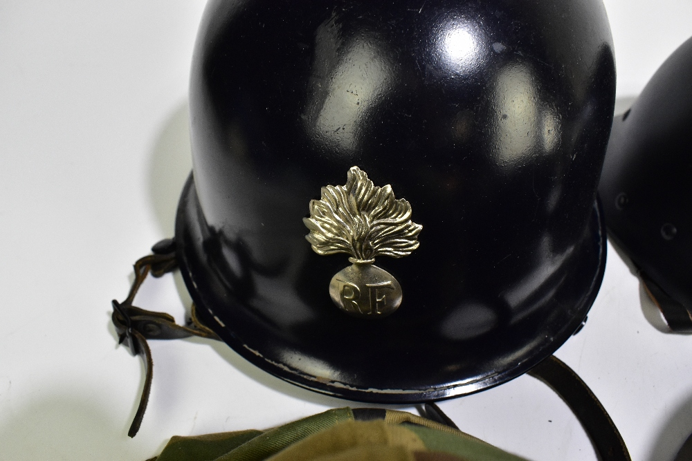 Six military and public service helmets comprising a khaki example with camouflage cover, - Image 2 of 3