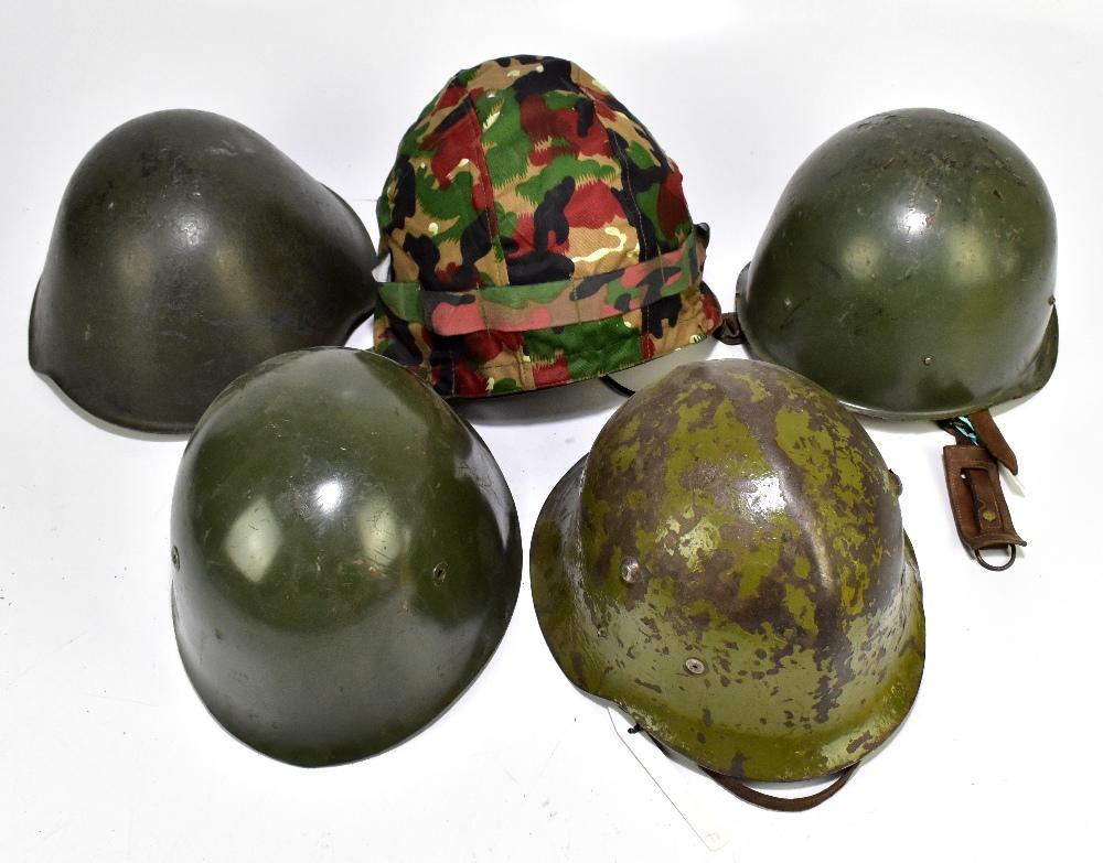 Five military helmets comprising Bulgarian Army M36 B1, Hungarian Army example, Bulgarian Army M51-