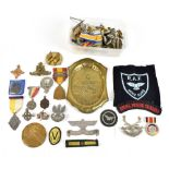 A collection of assorted cap badges and buttons, also further military items including an RAF Hong