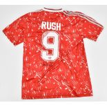 LIVERPOOL FC; a retro-issue Adidas home shirt with Candy logo, signed by Ian Rush with 'Rush 9'