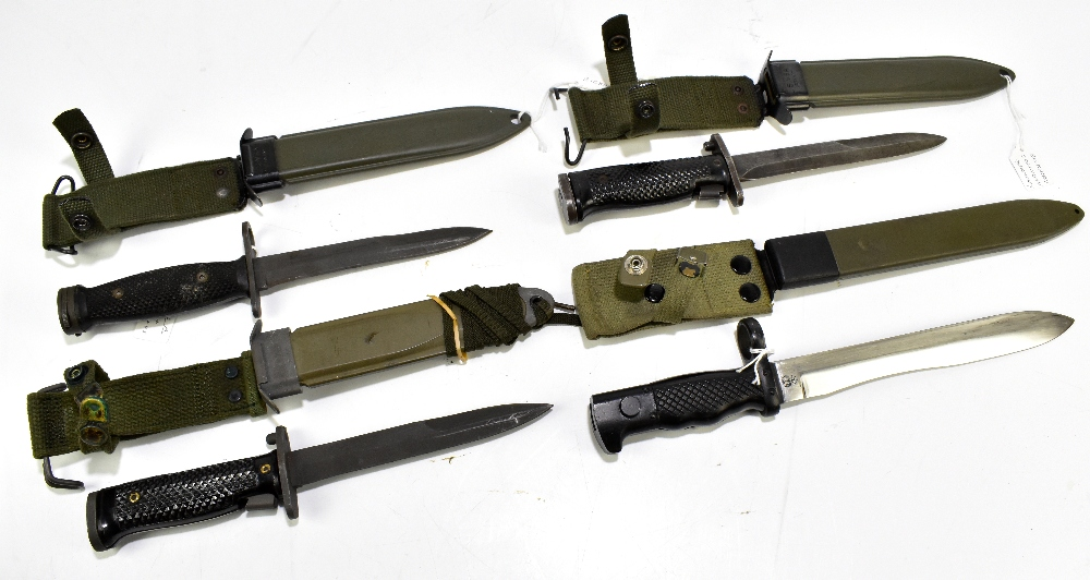 Three US M8 A1 bayonets and a Spanish Cetme 69 bayonet, all with scabbards (4).Additional