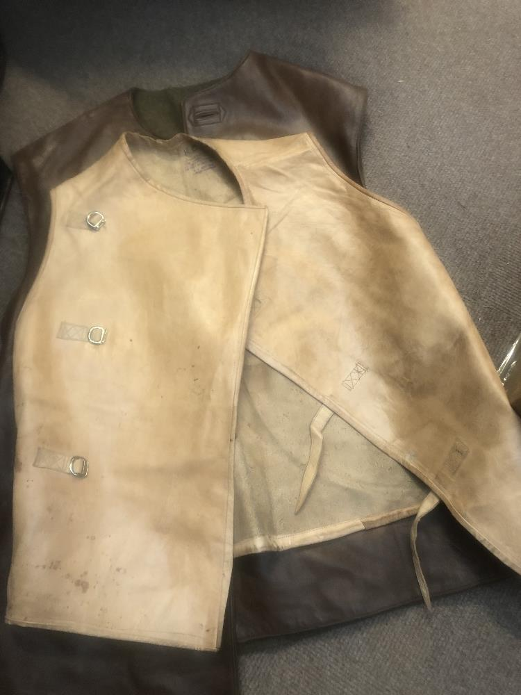 A collection of military uniform and accessories including two woolen great coats, two leather - Image 3 of 6