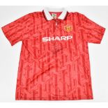 ERIC CANTONA; a signed Score Draw Official Retro Manchester United 1992-94 home shirt with Sharp