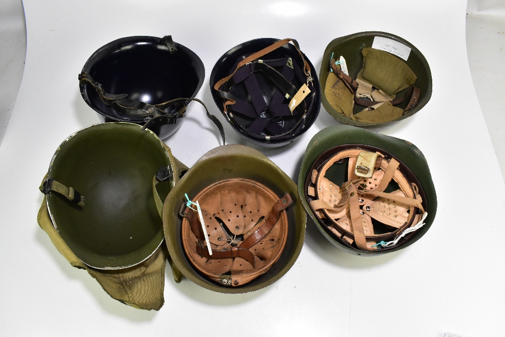 Six military and public service helmets comprising a khaki example with camouflage cover, - Image 3 of 3