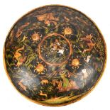 A 19th century Indian Mughal painted shield (Dhal), probably North Indian, decorated with figures