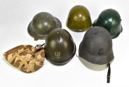 Five military helmets comprising a mid/late 20th century US helmet, Bulgarian Army M36C, a British
