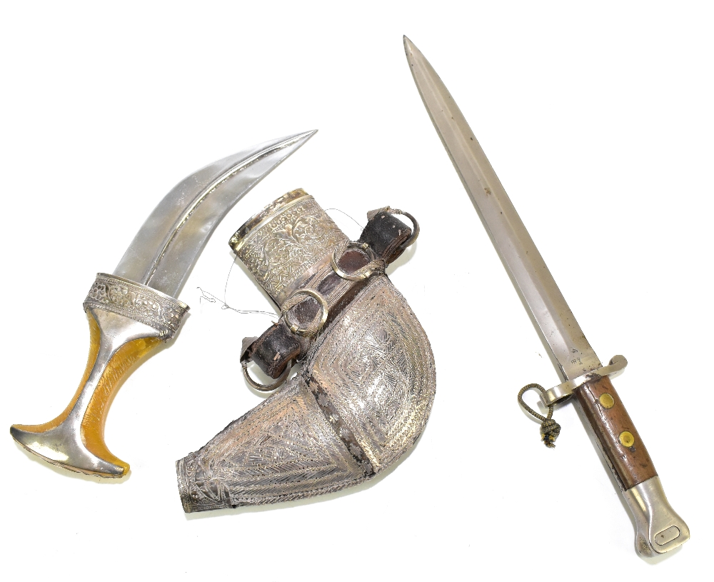 A WWII period bayonet, length 41.5cm, and a white metal mounted jambiya complete with sheath, length