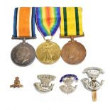 A WWI trio comprising War, Defence and Territorial War Voluntary Service Overseas Medals awarded