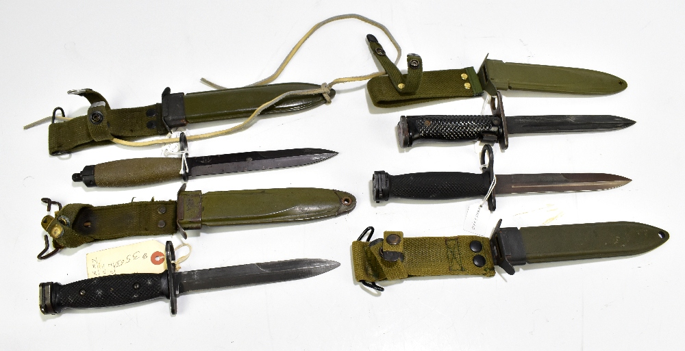 Three US M6, M7 and M8 bayonets and a Norwegian HPK AE3 (first type) bayonet, all with scabbards (
