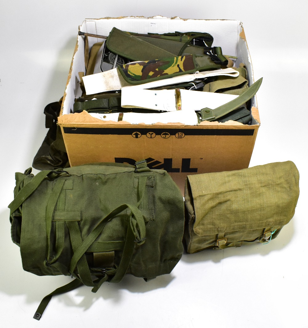 A collection of military rucksacks, haversacks, flask carriers and related accessories, various