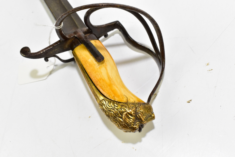 A sword comprised of associated parts, the fullered blade length 81.5cm, with carved ivory grip to - Image 3 of 4