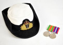 A Women's Royal Naval Service Wren's hat with bullion work crowned fouled anchor device and a WWII