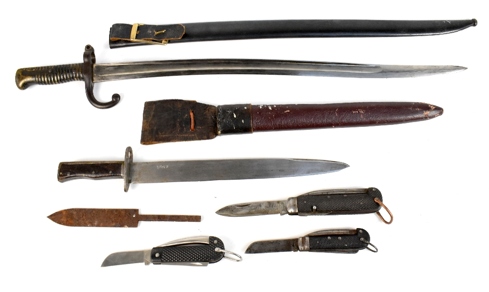 A 19th century French Chassepot-type bayonet, the blade back signed and dated 1879, with matching