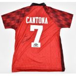 MANCHESTER UNITED FC; an Umbro official retro-style shirt with embroidered logo signed by Eric