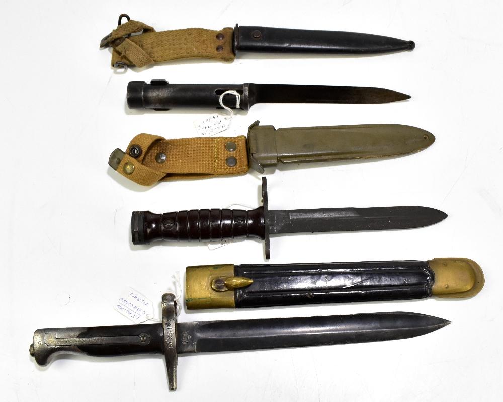 Three bayonets comprising Italian Carcano, Beretta BM-59 M70 and a further possibly Belgian FN FAL