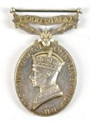 A Territorial Efficient Service Medal awarded to 7591332 Cfn. V.G. Butt R.E.M.E.Additional