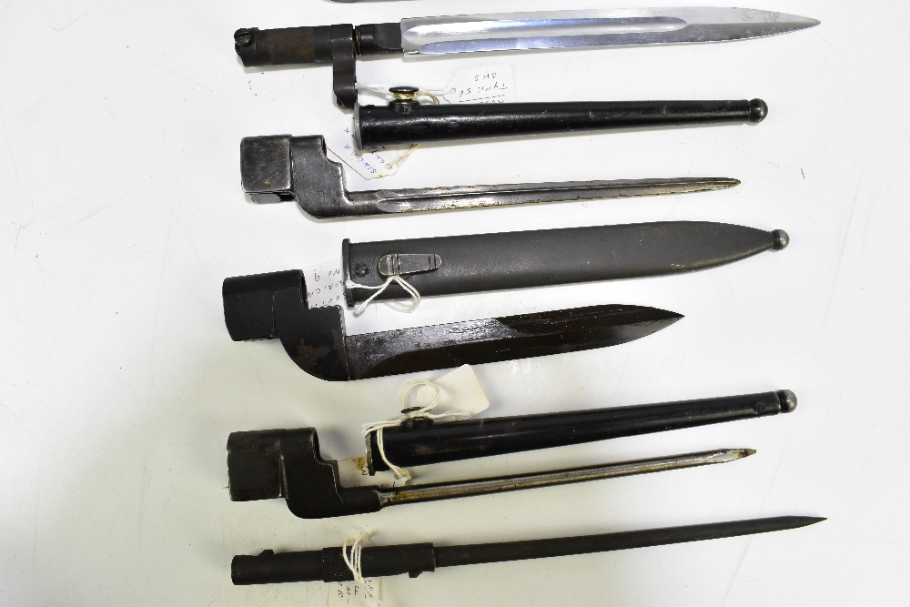 Seven socket bayonets including Swiss, Russian, South African and British examples, five with - Image 3 of 5
