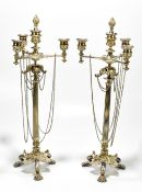A pair of modern silver plated four light candelabra with central detachable flaming torch finial