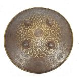 An early 19th century Indian shield (dhal) with script, floral and animal decorated border, four