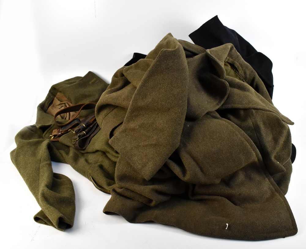 Three military greatcoats, two khaki and one navy (3). Additional InformationFraying, loose