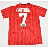 MANCHESTER UNITED FC; an Umbro retro-style shirt with Sharp logo, signed by Eric Cantona to