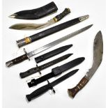 A US 1917 Remington bayonet with scabbard, an Australian L182 c1950s bayonet, both with scabbards, a