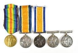 Five Scottish World War I medals comprising a War and Victory duo awarded to 21602 Pte. J. Fearn