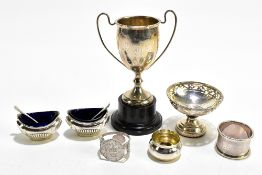 A group of hallmarked silver including a twin handled pedestal trophy cup, pedestal bonbon dish, a