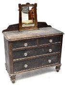 An early 19th century rustic pine chest of two short over two long drawers,