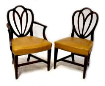 A set of five early 20th century mahogany dining chairs with overstuffed faux mustard leather seats