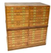 An early 20th century stained pine museum-style chest of collectors' display drawers,